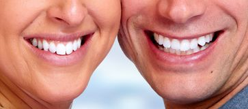 Smile teeth close-up. Smiling young face with perfect white teeth stock images