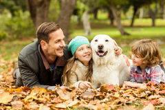 Smiling young family with dog Stock Image