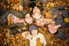 Smiling young family doing a head circles Stock Image