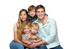 Smiling young family of five enjoying time Stock Photos