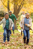 Smiling young family playing together Royalty Free Stock Photos