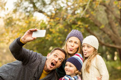 Smiling young family taking selfies Royalty Free Stock Images