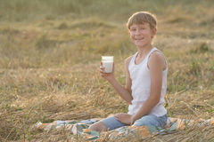 Smiling young farmer during break in field Royalty Free Stock Photos