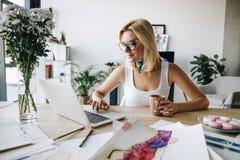 Fashion designer using laptop Stock Image