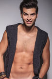 Smiling young fashion man posing naked Royalty Free Stock Photo
