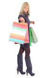 Smiling young female. With shopping bags against a white background Royalty Free Stock Photo
