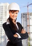 Smiling young female architect Stock Images
