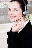 Smiling young female callcenter agent with headset Stock Images
