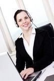 Smiling young female callcenter agent with headset Royalty Free Stock Image