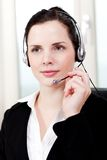 Smiling young female callcenter agent with headset Stock Photo