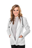 Smiling young female doctor with hands on the pocket, isolated Royalty Free Stock Photos