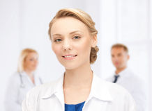 Smiling young female doctor in hospital Stock Image