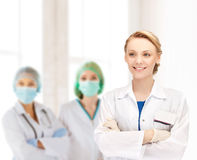 Smiling young female doctor in hospital Stock Photos