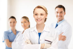 Smiling young female doctor in hospital Stock Images