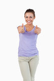 Smiling young female giving thumbs up Stock Photography