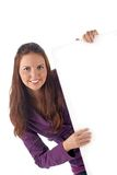 Smiling young female holding big blank sign Royalty Free Stock Photography