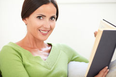 Smiling young female holding a book Stock Photo