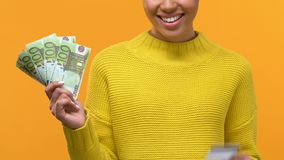Smiling young female holding euro banknotes and credit card in hands, payment. Stock footage stock video footage