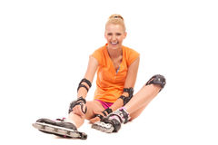 Smiling young female on inline skates resting. Royalty Free Stock Photos