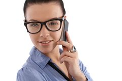 Smiling young female on mobile phone Stock Image