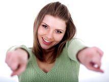 Smiling young female pointing Stock Images
