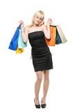 A smiling young female posing with shopping bags Royalty Free Stock Image