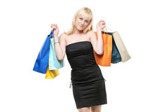 A smiling young female posing with shopping bags Stock Images