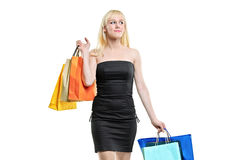 A smiling young female posing with shopping bags Stock Photography