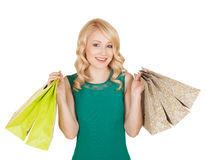 Smiling young female posing with shopping bags royalty free stock photos