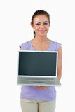 Smiling young female showing her laptop Royalty Free Stock Image