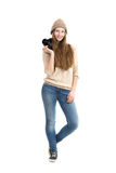 Smiling young female standing with slr camera Stock Image