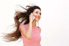 Smiling young female talking on mobile phone Stock Photography