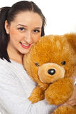 Smiling young female with teddy bear Stock Image