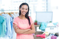 Smiling young female volunteer Stock Images