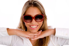 Smiling young female wearing sunglasses Stock Photos