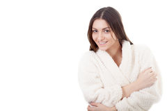 Smiling young female in white bathrobe Royalty Free Stock Image