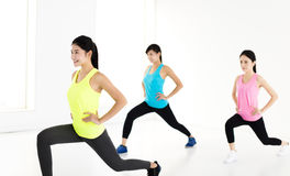 Smiling young fit group stretching and squat Royalty Free Stock Photography