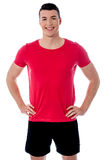 Smiling young fitness trainer. Happy young male athlete posing to camera Royalty Free Stock Photos