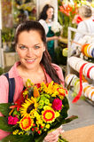Smiling young florist woman colorful bouquet shop Royalty Free Stock Images