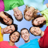 Smiling young friends. Happy joyful friends forming a circle of head Royalty Free Stock Image