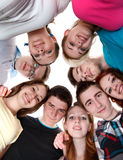Smiling young friends. Happy joyful friends forming a circle of head Stock Image