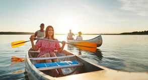 Laughing young woman having fun with friends in a lake royalty free stock images