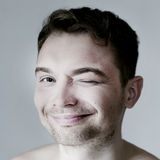 Smiling young funny man posing. Royalty Free Stock Photography