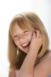 Smiling young girl. Young girl smiling on the telephone Royalty Free Stock Photography