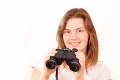 Smiling young girl with binoculars Royalty Free Stock Image
