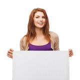 Smiling young girl with blank white board Royalty Free Stock Photography