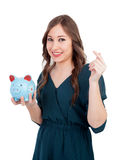 Smiling young girl with a blue money-box Stock Image