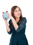 Smiling young girl with a blue money-box Royalty Free Stock Image