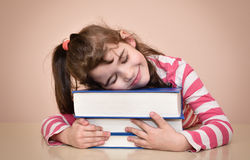 Smiling young girl and books Stock Images