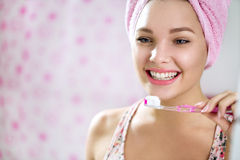 Smiling young girl brushing teeth Stock Images